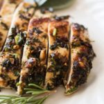 macadamia and sage crusted chicken breast sliced into strips