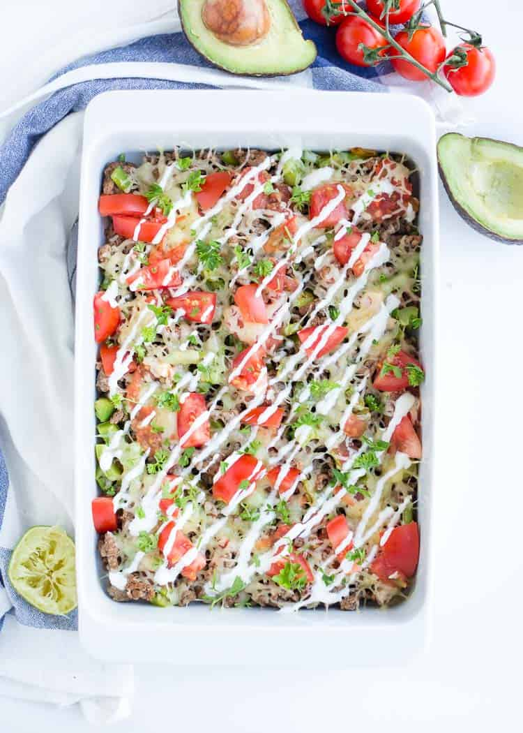 Meal Prep Taco Salad Casserole in a white casserole dish with avocados