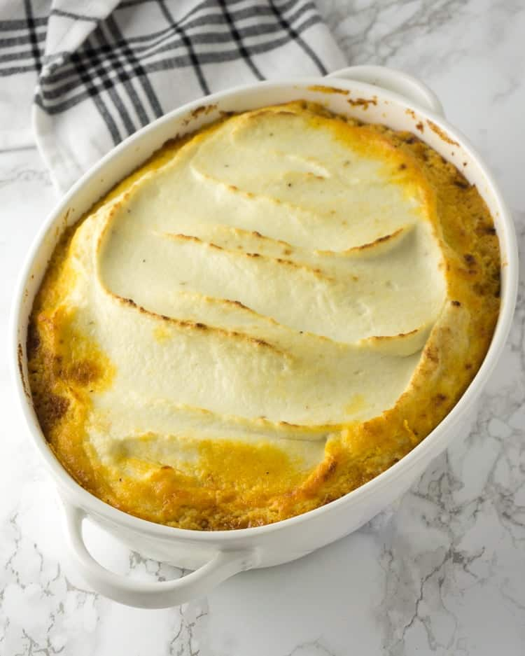 large white casserole dish of Shepherd's Pie topped with a Cauliflower topping