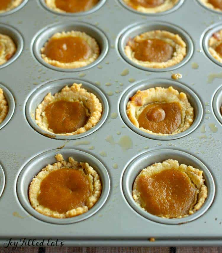 mini muffin tin full of mini pumpkin pies
