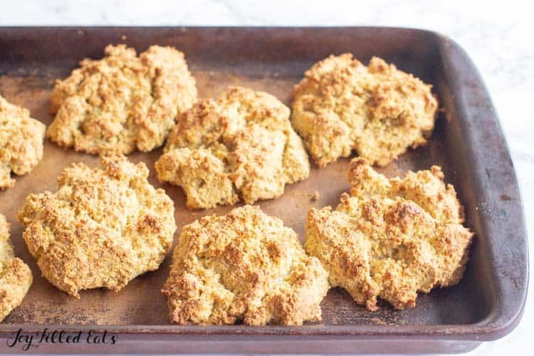 baked pumpkin drop biscuits on a stone baking sheet