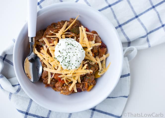 bowl of slow cooker no bean chili with a white spoon