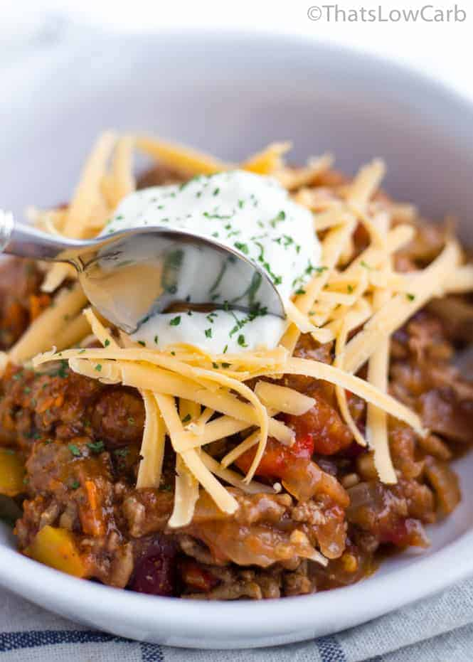spoon dipping into bowl of slow cooker no bean chili