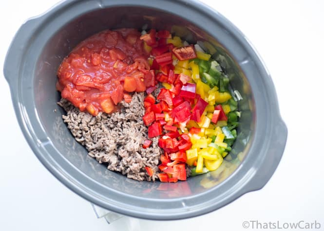 Crock pot with the ingredients for the no bean chili