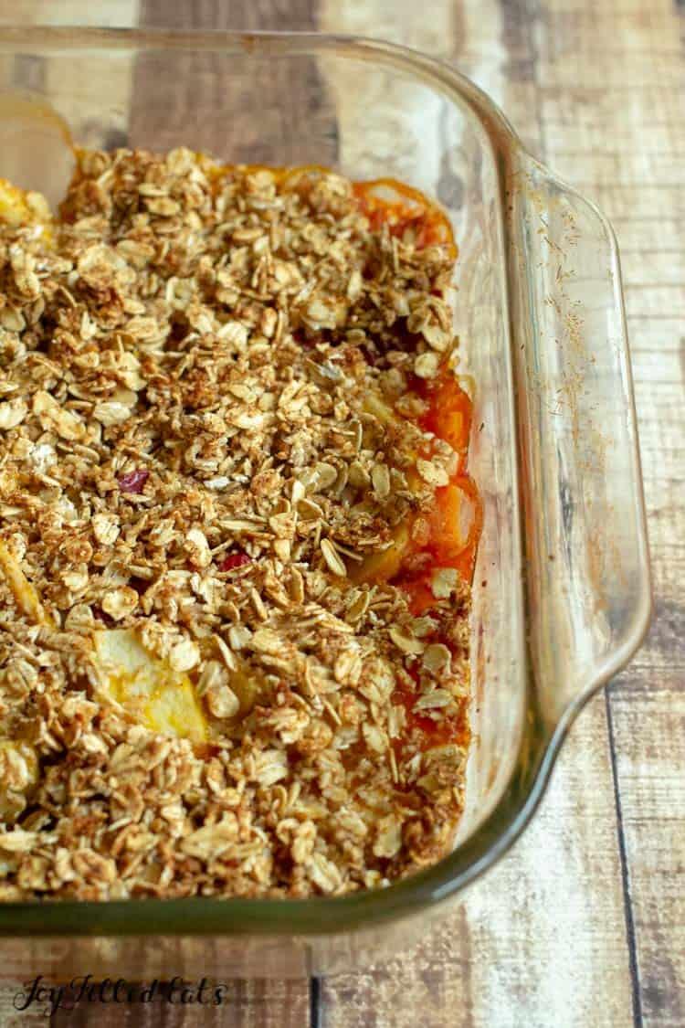 close up on apple crisp in casserole dish