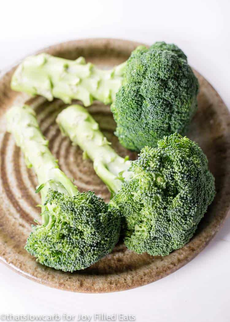 raw broccoli on a plate