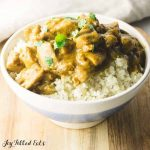bowl of keto coconut chicken curry on riced cauliflower