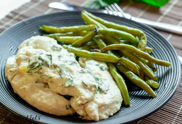 plate with creamy lemon chicken and green beans