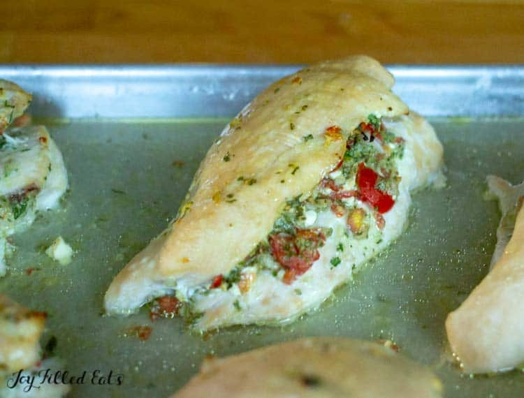 close up of the baked chicken breast stuffed with greek salsa