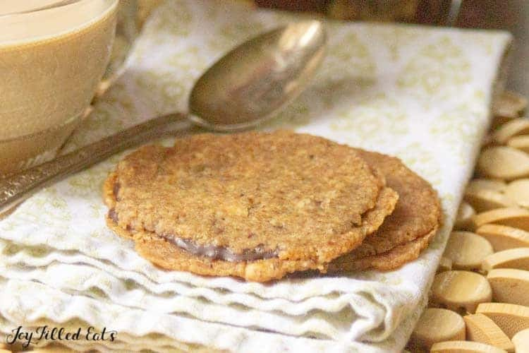 close up of two florentine cookie set on a napkin with spoon