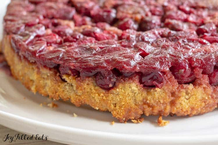 close up of the edge of the upside down cake with cranberries