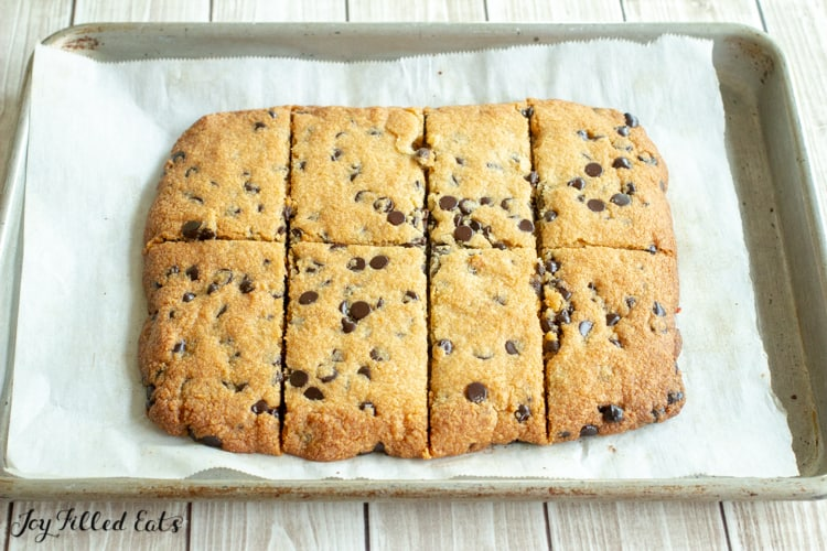 baked cookie bars on a parchment lined tray