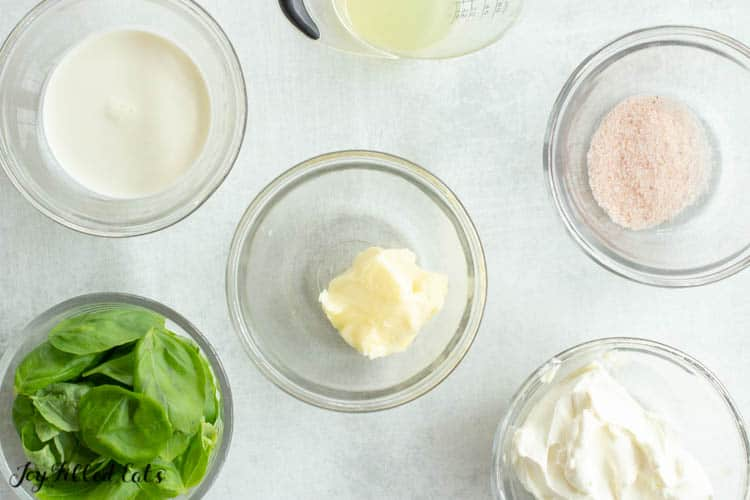 overhead view of various glass prep bowls with ingredients for creamy lemon chicken with basil