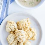plate of almond flour biscuits and bowl of biscuits and gravy from above
