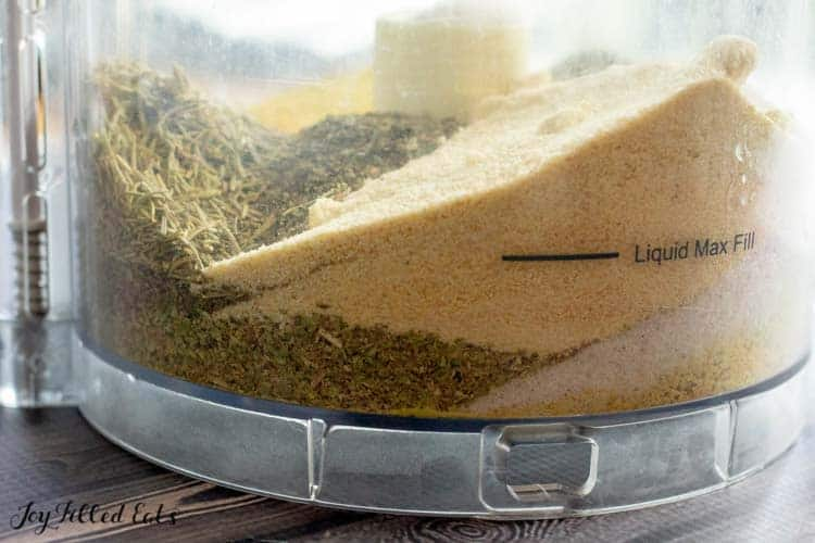 side view of food processor with layers of ingredients for chicken bouillon powder