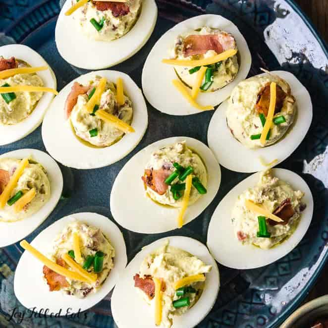 Overhead shot of keto deviled eggs on round blue plate
