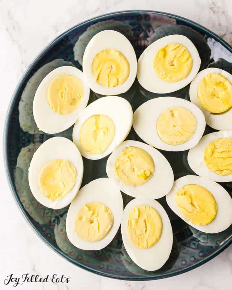a plate of halved hard boiled eggs