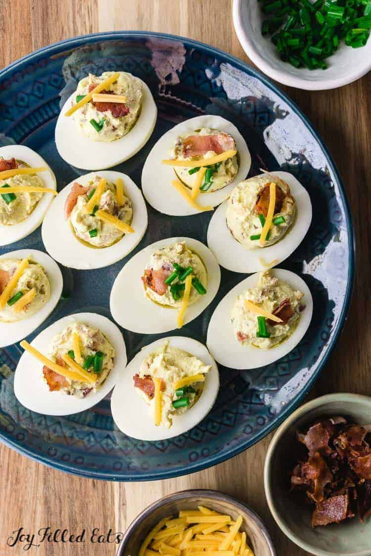 overhead shot of a plate with keto deviled eggs with bacon
