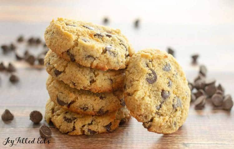 stack of eggless chocolate chip cookies with one cookie leaning on stack