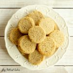 pile of ginger molasses cookies on white plate