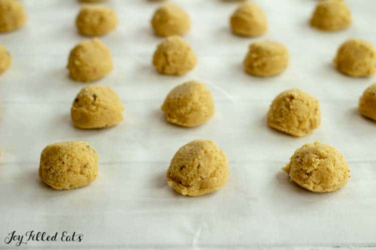 ginger molasses cookie dough balls on parchment