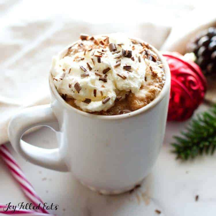 mug of keto peppermint mocha topped with whipped cream and chocolate shavings
