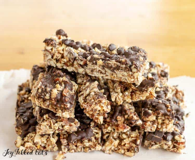 pile of no bake keto granola bars on a white plate