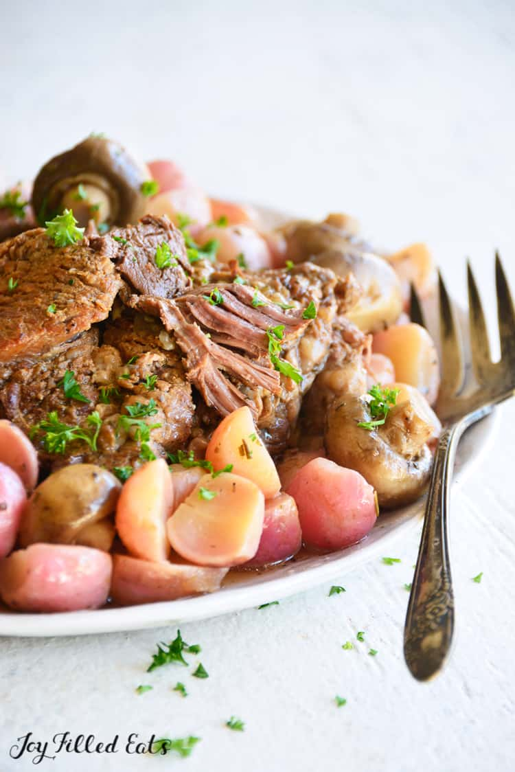 close up of the instant pot pot roast with vegetables in a serving bowl