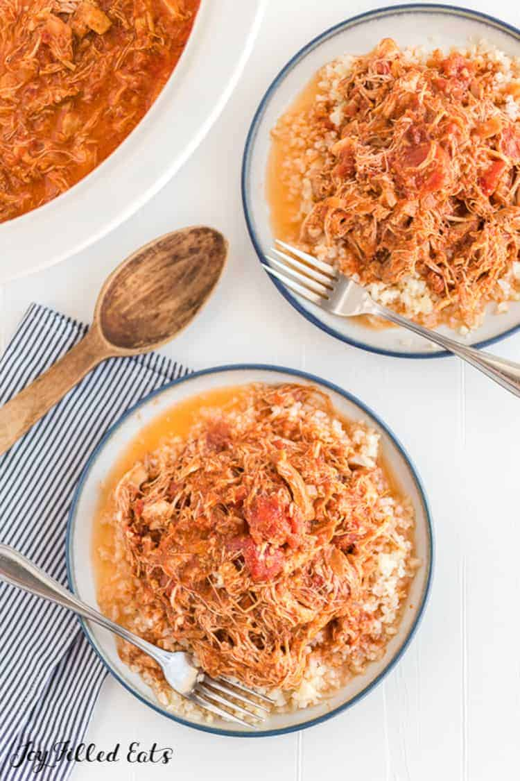 the chicken tikka masala slow cooker recipe in a crock pot and in bowls