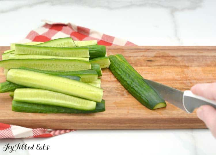 cut cucumbers on a cutting board