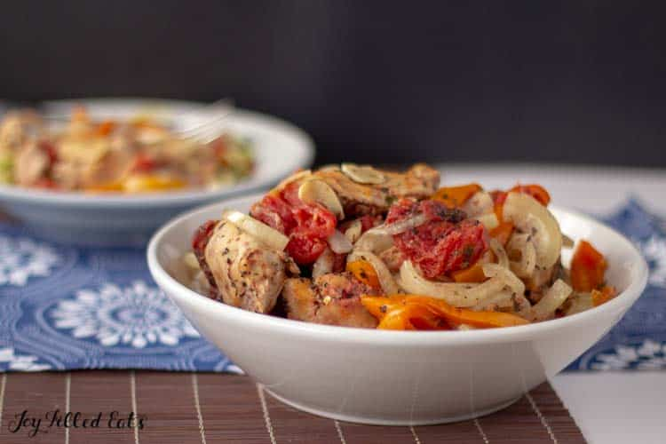 a large serving bowl of Slow Cooker Chicken Cacciatore