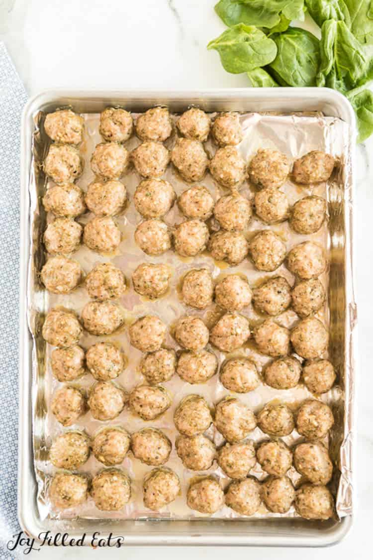 cooked mini meatballs on a baking sheet for the Italian Wedding Soup
