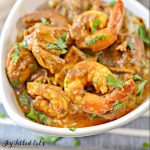 close up on shrimp in bowl of shrimp curry