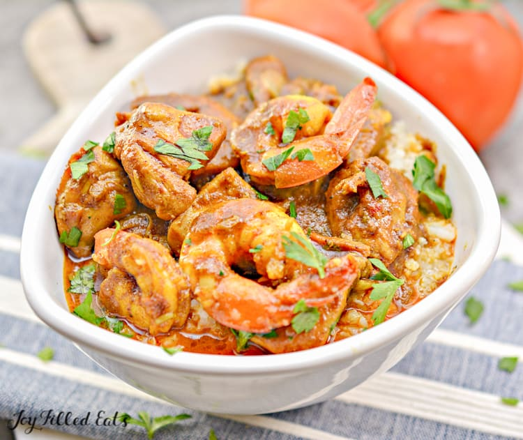 shrimp and chicken in indian curry sauce sprinkled with parsley