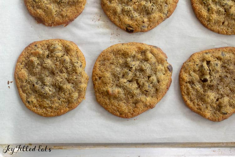 almond flour chocolate chip cookies on a parchment lined sheet pan close up