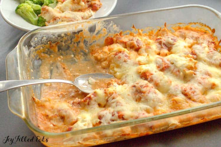 a spoon in the creamy keto pizza casserole with chicken