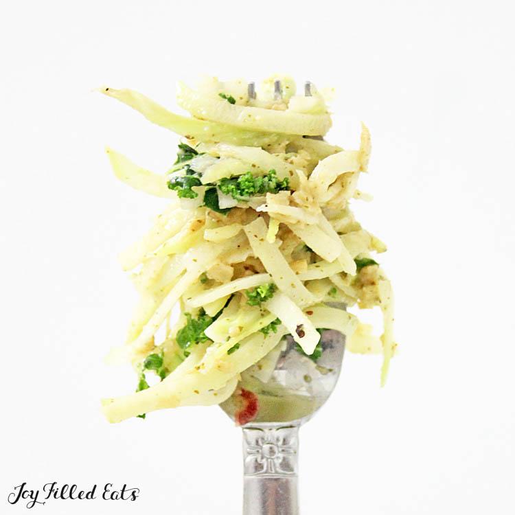 twirled kohlrabi noodle strands around a fork close up