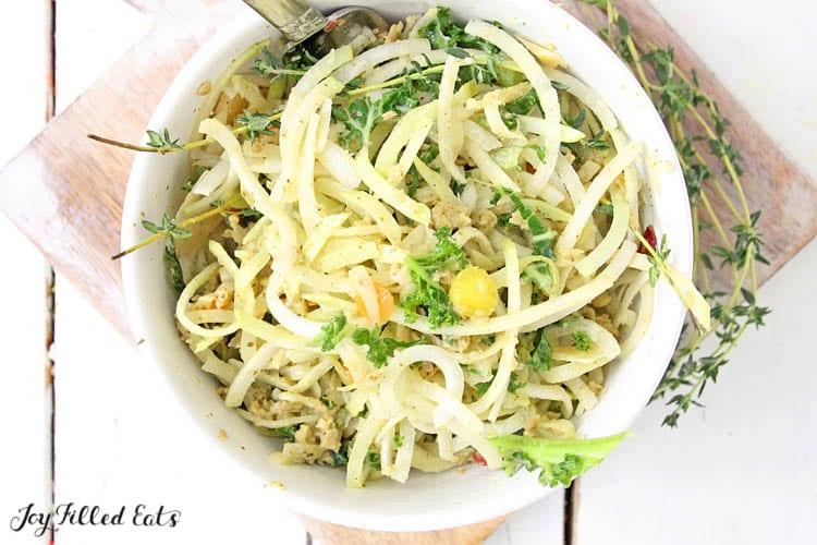 overhead shot of a white bowl of Kohlrabi Salad with Homemade Italian Dressing