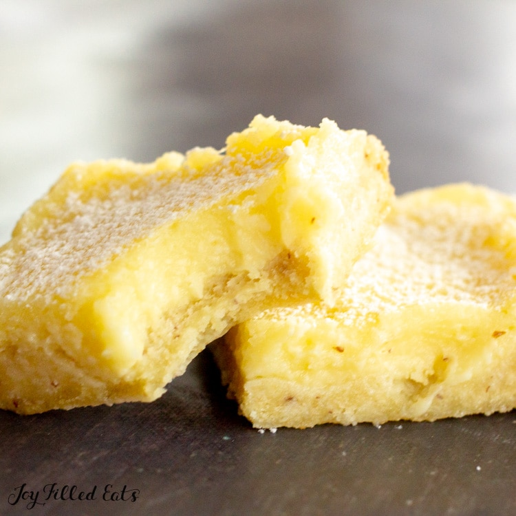 one of the keto sugar free lemon bars with a bite out of it