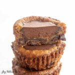 close up of ganache filling in sliced chocolate chip cookie cup