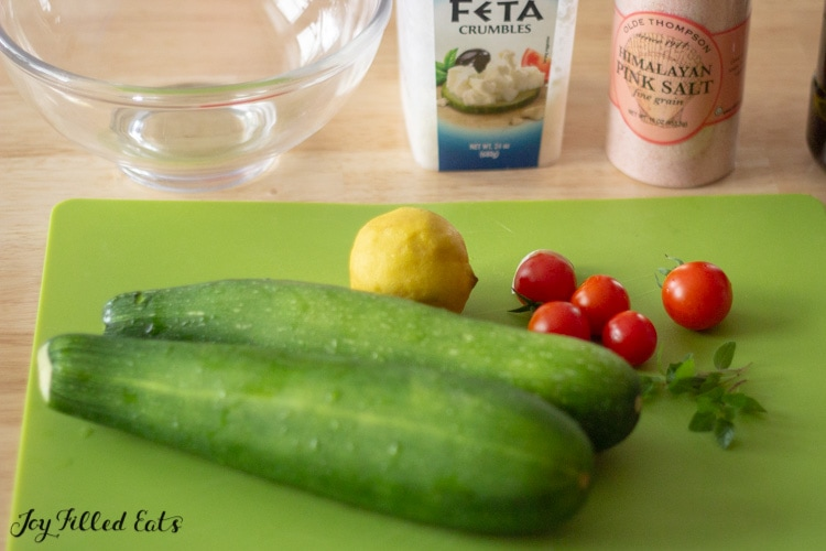 ingredients for the zucchini salad on a cutting board