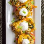 Chicken stuffed peppers topped with a dollop of sour cream from above