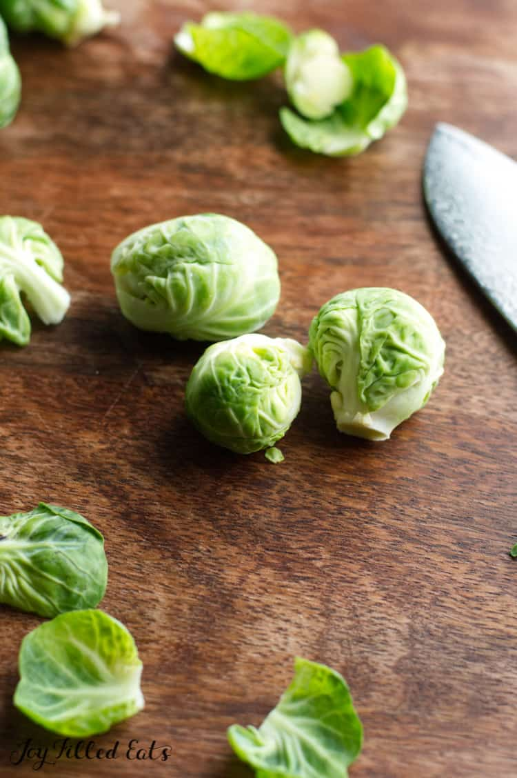 brussel sprouts on a cutting board