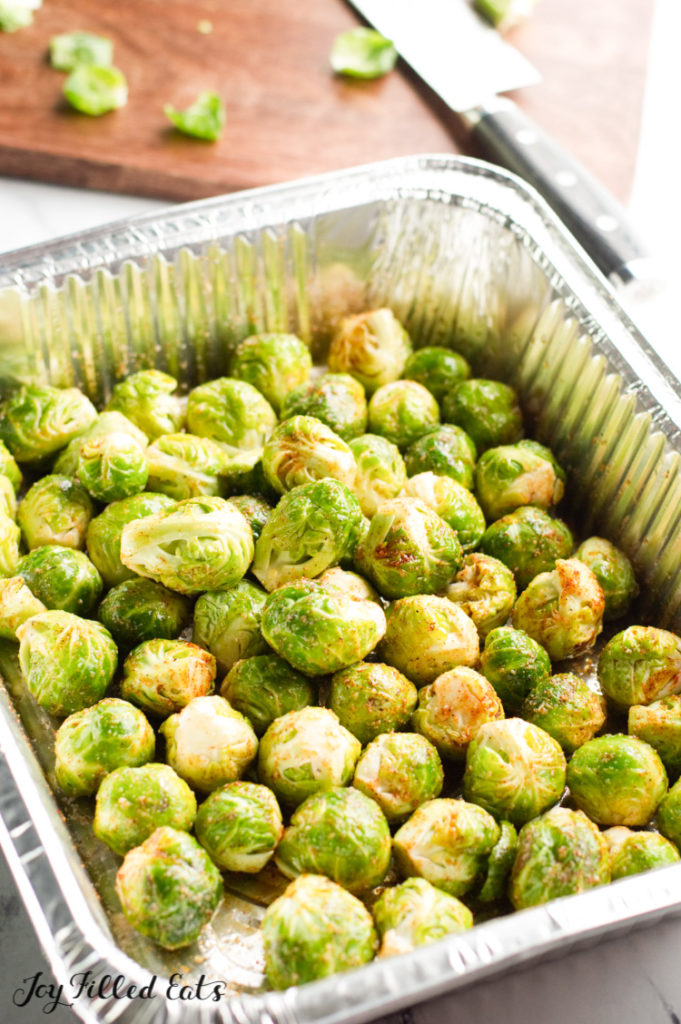 Brussel sprouts ready for the grill in an aluminum pan