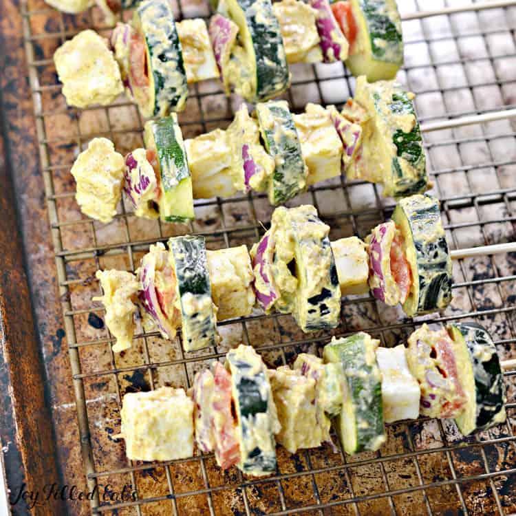 paneer tikka kebabs on a sheet pan before cooking