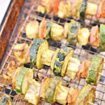 paneer tikka kebabs on a drying rack in a sheet pan close up