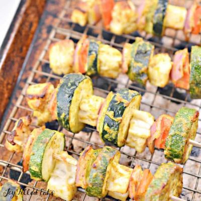 paneer tikka kebabs on a drying rack in a sheet pan close up