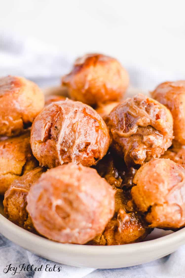 close up of donut holes with cinnamon in a bowl