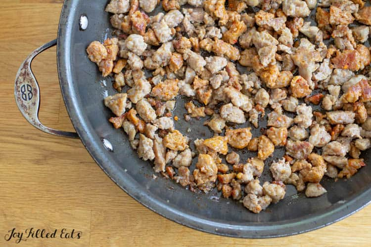 crumbles of sausage browned in a large frying pan