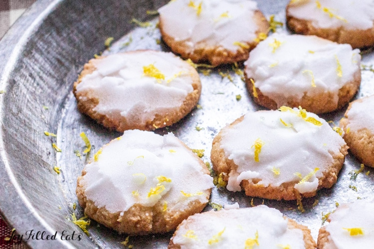 overhead view of keto iced lemon cookies in a small round platter